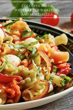 Colorful pasta with melted tomatoes and mozzarella. Perfect for a hot summer day. #mozzarella #pasta #tomatoes #basil #summer #delicius