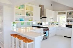 White kitchen, open shelving, mirrored backsplash