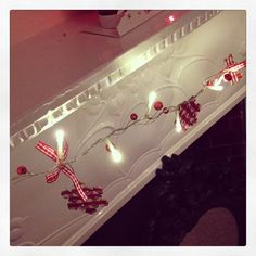 Wooden Christmas Tree Or Snowflake Light Up Garland A lovely light up garland with wooden red white gingham shapes- and Christmas bows Also with red