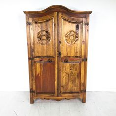 Rustic Daisy Armoire. - Rustic wooden armoire with carved floral accents on the doors- Good overall condition