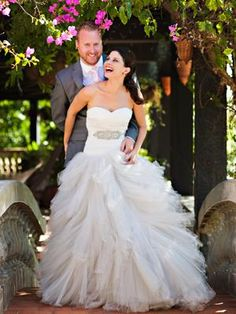 Happy couple in  Puerto Rico. (And check out the bride's gown - wow!)