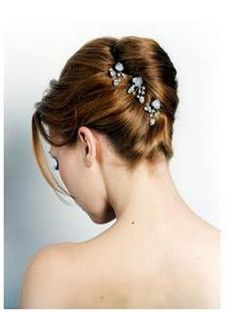 Wedding Hairstyles Updo How to Make an Easy French Twist Updo - The French twist is an up-do hairstyle that can be formal or casual; some women find the French twist convenient for everyday, especially to keep hair out of the way. Retro Hairstyles, Twist Hairstyles, Bride Hairstyles, Straight Hairstyles, Hairstyles With Bangs, Long Haircuts, Hairstyles Pictures, Formal Hairstyles, Hair Pictures