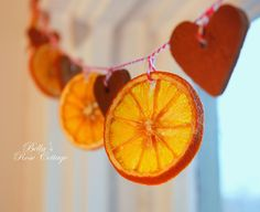 orange slices and cinnamon hearts garland.   http://bellasrosecottage.blogspot.com/2013/12/a-scented-garland.html