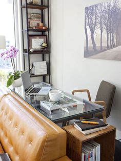 Behind the couch, like a sofa table, but facing the room so you can interact...might be ugly with the cords...what about facing away? ... 10 Perfect Living Room Home Office Nooks: Short on Space but Not Style