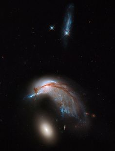 This image shows the two galaxies interacting. NGC 2936, once a standard spiral galaxy, and NGC 2937, a smaller elliptical, bear a striking resemblance to a penguin guarding its egg. Image released June 20, 2013. - Credit: NASA, ESA and the Hubble Heritage Team (STScI/AURA)