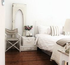 I love this bedroom, especially the old door and the vintage suitcases...oh, and the fact it's white of course!