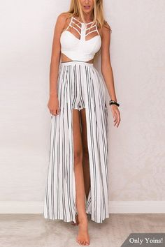 Be chic with this sleeveless playsuit. You'll definitely love its cage strappy and cut out detail. Also, the shorts with striped pattern is accented with a maxi overlay and high slit. Pair this playsuit with sandals to get that boho chic look.