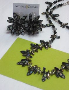 Susan Andrea Vachon black beaded necklace and hand-forged bloom earrings.