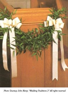 Pew Bows with Greenery - in addition to ribbons, possibly have white flowers at each apex
