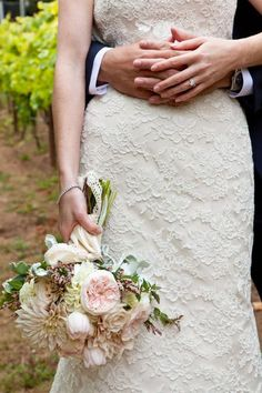 We all know I love lace! A bouquet of soft roses,tulips and dahlias compliments the dress fabulously