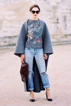cape // sweatshirt // boyfriend jeans // fringe
