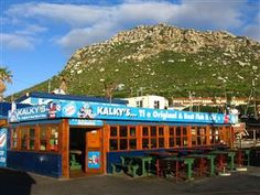 Located along Kalk Bay Harbour, Kalky's is a laid back and down to earth eatery bustling with trawlers, marine life and hungry palate indulg. Fishing Villages, Cape Town, Beautiful World, The Locals, Summer Vibes, South Africa, Mansions, House Styles, City