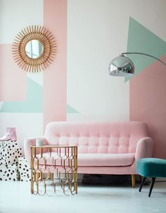 The geometric shapes and the combination of millennial pink, copper and teal make this an interior of our dreams!