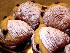 Sfogliatelle/Cannoli    (Italy)  The sfogiatelle's better known cannoli cousin is going to have to step to the side for just a moment. This clamshell-shaped layered dough (think of a thicker phyllo) is baked, split open and stuffed with cream or a ricotta-based lemon or orange-infused filling for a delectable treat that's probably not on your doctor's list of recommended snacks. Luckily your doctor didn't come on vacation with you. A mangiare!
