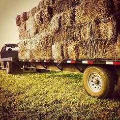.Hay bales on a flat bed. Reminds me of my youth on the farm!