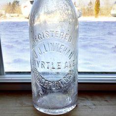 J J Linnehans Antique Soda Bottle Myrtle Ave Bridgeport CT | Etsy Soda Bottles, Glass Bottles, Bridgeport Connecticut, Antique Shelves, Cobalt Glass, Winter Light, Vintage Keys, Myrtle, Beer Bottle