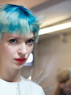 a casually-crafted, layered bob with an accent on a disconnected fringe. deep intense blue, inspired by the sea, fades into the lightest platinum blonde