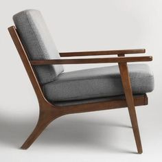 Textured gray cushions with a subtle two-tone weave pop against a sleek wood frame finished in dark espresso. This mid-century-inspired chair boasts a vertical slatted back and a deep seat for comfortable lounging.