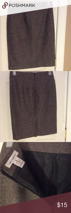 Liz Claiborne Skirt Sz 6 ⚡️Like New⚡️ Slim fitting Liz Claiborne skirt in a metallic thread fabric! Not gonna lie, it's a hard to describe color. I want to say it's like a dark grey but with some other subtle thread colors running through it besides the metallic one! Measures: 23 1/2 Long, Waist: 14 1/2 in across front, Bottom across front: 18, Hips across front: 19, zipper length: 7 in & back slit at bottom: 6in. Fully lined. Material: Shell: 64% poly/ 30% Wool/ 6% other Fibers. Lining…