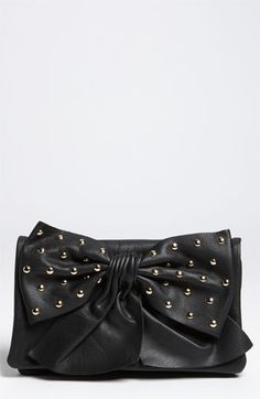 red valentino studded bow clutch in black.....its so rock and roll but there is still  pretty bow