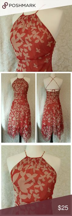 Red and Beige BCBGMaxAzria Dress Red and Beige floral patterned dress with halter neck and cross tie in back. BCBGMaxAzria Dresses Midi