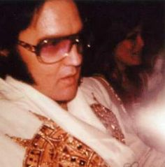 Elvis on his way for his Louisville ( Kentucky ) concert in may 21  1977. Ginger was at his side for that tour.