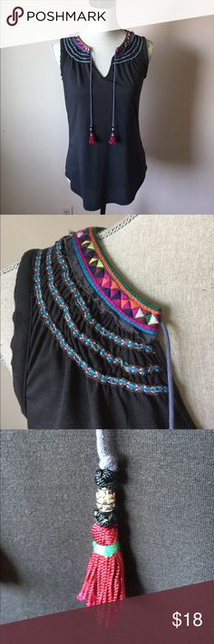 Tribal Sleeveless Top Beautiful tribal pattern collared top. The ties are a pretty cornflower blue with magenta tassels. They can be tied or left open to hang. Double edge armhole. Pretty gathered Ruffle-like stitching along the top. Tag is XS but can fit an XS/S comfortably. 65% polyester 35% rayon. Trim is 100% cotton. 🚫No Trades ace delivery Tops