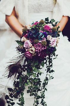 Purple Wedding Flowers photo: Steve Gerrand via Rock N Roll Bride; Purple Wedding Bouquets with Pretty Details - Purple wedding bouquets are coming in hot this season with their pretty and bold details. Check out these wedding bouquets to be inspired. Purple Wedding Bouquets, Winter Wedding Flowers, Bridal Flowers, Peacock Wedding Flowers, Hand Bouquet Wedding, Flower Bouquets, Bridal Bouquets, Wedding Dresses, Mod Wedding