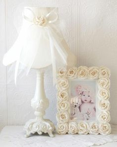 This fancy bell-shaped, scalloped kids lamp shade is made with the finest cream Dupioni Silk and is been adorned with a large, gorgeous bow, made with layers of delicate cream Tulle, satin ribbons and