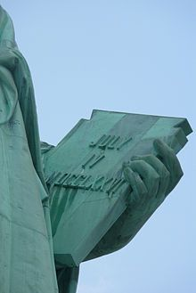 Detail of the Statue of liberty with the independence date in Roman numerals.