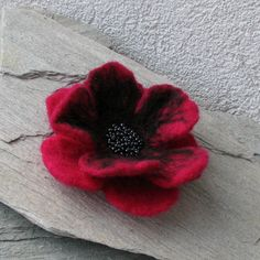 .   Favorite Like this item?  Add it to your favorites to revisit it later.  Felt Brooch - Poppy Felted Flower - Hand Felted Brooch - Fuschia Flower Brooch - Wool Flowers Felted BroochFrom albado       This felted flower brooch is a super accessory!  It can adorn jacket, hat, dress, or handbag!  It measures about 11 cm.  Colour fuschia, pink. It has a brooch pin back.  It's ready to ship.
