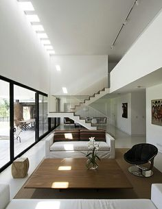 Completed in 2008 in Buenos Aires, Argentina. Images by Federico Kulekdjian , Daniela Mac Aden. The project consists of a single family suburban house placed within a corner plot in a traditional Country Club in the Pilar area, Buenos Aires,. Modern Interior, Home Interior Design, Interior Architecture, Suburban House, World Of Interiors, Fireplace Design, Home And Living, Living Room, My Dream Home