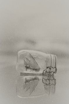 Ship in a bottle | Glass | Miniature small | Floating on water | Black and white | Grey