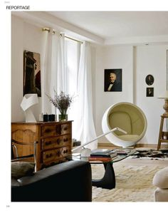 Mid Century Modern living room with famous egg chair, from Cote Paris decorating magazine. Bauhaus movement it is a style that influences design today.