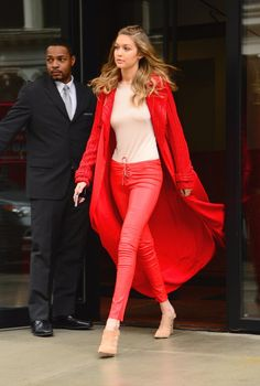 Gigi completed red lace-up Chrome Hearts skinnies with a beaded Sally LaPointe trench and neutral outfit acctourements, including Raye taupe heels and an Atea Oceanie bodysuit.