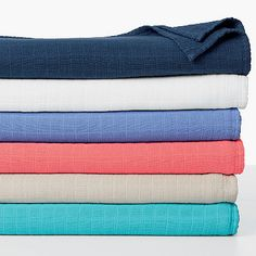 Virtually weightless cotton blanket woven in three gauzy layers for an airy softness that offers year-round beauty to the top of the bed.