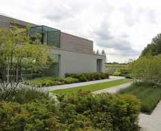 Short-listed for the RIBA House of the Year Awards this unique contemporary house sits on a ridge facing the South Downs. In a spectacular setting such as this it is. House Landscape, Landscape Plans, Landscape Design, Landscape Architecture, Contemporary Garden Design, Contemporary Landscape, Sussex Gardens, Garden Spaces, Patio Design
