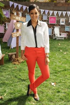 Tia Mowry rockin an Alice +Olivia top and red denim. Simple yet chic ♥
