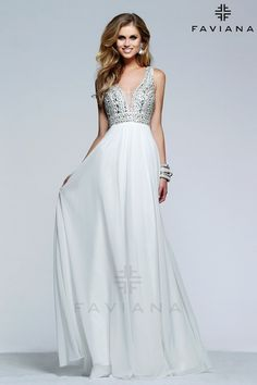 Stunning white long dress! So gorgeous for a destination wedding! Also perfect for prom or military ball. | GGM - Glamour Gowns and More // prom dresses