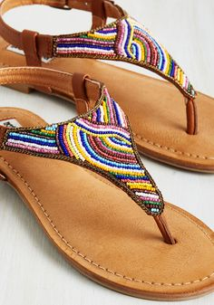 With these colorful sandals buckled around your ankles, you're going everywhere fast! Enriching your steps with cognac leather straps and bright beadwork, these festive flats are trusty travelers. Beaded Shoes, Beaded Sandals, Crochet Sandals, Crochet Shoes, Shoes Flats Sandals, Leather Sandals, Comfy Shoes, Cute Shoes, Bohemian Sandals