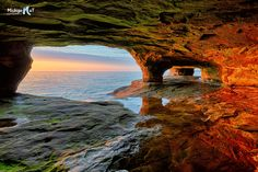 Beautiful sea cave sunset on Lake Superior near Munising, Michigan and Pictured Rocks National Lakeshore. Michigan Vacations, Michigan Travel, Lake Michigan, Munising Michigan, Wisconsin, Pictured Rocks National Lakeshore, Sea Cave, Wonderland, Lake Superior