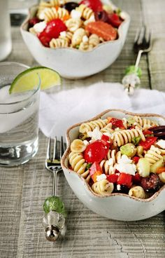 Rotini pasta is tossed with fresh vegetables, feta cheese, pepperoni and a homemade Greek dressing to create the best pasta salad you'll ever eat.