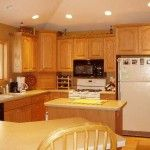 Breakfast bar, recessed lighting, vaulted ceiling and island