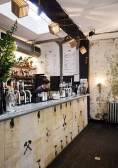 Designer-makers East London Furniture have temporarily fitted out the interior of London bar DreamBags JaguarShoes using nothing but scrap materials found on the local streets.