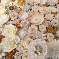 This beautiful flower wall is headed to Chicago for an event! All hand made custom paper flowers in gold and white.