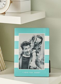 Up your shelf styling game with personalized photo frames and other home décor pieces from Tiny Prints.