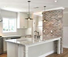 Exposed brick kitchen island