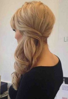Sweeping your curls to one side makes the look fresh and elegant! Photo via Pinterest