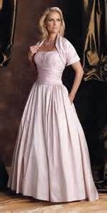 ... evening dress in pale pink with matching bolero sleeves from Victorian