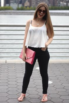 Pop of color. Pink clutch. Black skinny jeans. Long Island city. New York. Long hair. Dirty blonde. Crop top.